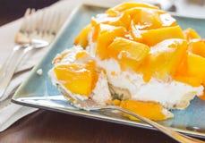 ... topped with fresh mango and orange jello with macadamia nut crust