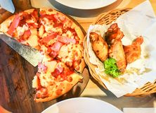 Hawaiian pan pizza with spicy wing chicken for lunch. Close up Hawaiian pan pizza with spicy wing chicken for lunch stock images