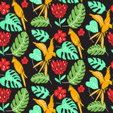 Hawaiian pattern with parrots, palm leaves and hibiscus flowers. Bright seamless texture with exotic flora and fauna Stock Photo
