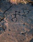 Hawaiian petroglyph. Petroglyph figure carved into a lava rock on Big Island, Hawaii Stock Image