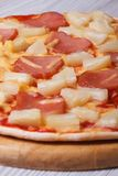 Hawaiian pizza close up. Vertical Stock Photo