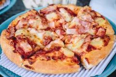 Hawaiian pizza, Hawaiian pizza with ham and pineapple royalty free stock photography