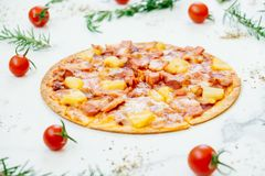Hawaiian pizza. With pineapple and ham - Unhealthy food style Royalty Free Stock Images