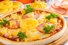 Hawaiian Pizza with pineapple and corn Royalty Free Stock Photos