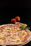 Hawaiian Pizza , pineapple , ham and cheese royalty free stock photos