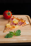 Hawaiian Pizza , pineapple , ham and cheese Royalty Free Stock Photography