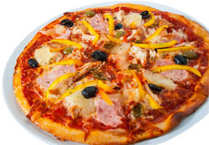 Hawaiian pizza with pineapple, ham, chicken, cheese, olives and vegetables isolated on white Stock Photography