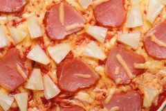 Hawaiian pizza with pineapple and ham macro top view Royalty Free Stock Image