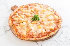 Hawaiian pizza on table. Italian food style royalty free stock images