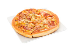 Hawaiian Pizza on white dish isolated Stock Images
