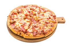 Hawaiian pizza. On wooden plate isolated on white background stock image