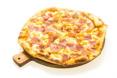 Hawaiian pizza on wooden tray. Isolated with white background Royalty Free Stock Photos