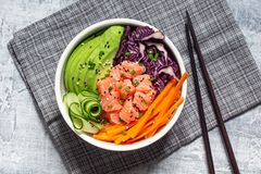 Hawaiian Poke Bowl with Salmon and Sliced Vegetables stock image