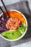 Hawaiian Poke Bowl with Salmon and Vegetables Over Rice royalty free stock photography