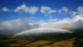 Hawaiian Rainbow. Rainbow over hawaiian sugercane fields Stock Photo