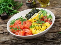 Hawaiian salmon fish poke bowl with rice, avocado, mango, tomato, sesame seeds and seaweeds. Buddha bowl. Diet food Royalty Free Stock Photos
