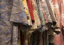 Hawaiian shirts on rack. Hawaiian shirts hung on rack stock images