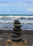 Hawaiian Stacked Stones on Black Sand royalty free stock images