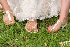 Hawaiian style footwear in wedding. Flip-flops is a footwear in Hawaii for brides Royalty Free Stock Image