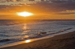 Hawaiian Sunset 2. Landscape view of a beautiful sunset over the ocean at the beach at Kauai, Hawaii Stock Images