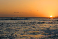Hawaiian Sunset Over the Pacific Ocean. The sun setting over the ocean in Honolulu, Hawaii Stock Photos