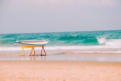 Hawaiian surfboard on the beach of the Mediterranean sea in Israel stock photos