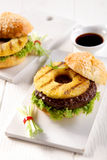Hawaiian teriyaki burger with grilled pineapple Stock Images