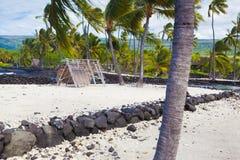 Hawaiian thatched roof dwellings Stock Photo