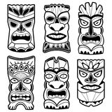 Hawaiian tiki statue masks black and white set. Vector illustration set of cartoon Hawaiian tiki god statue black and white masks Stock Photography
