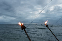 Hawaiian torches at sunset, Lahaina, Maui stock photos