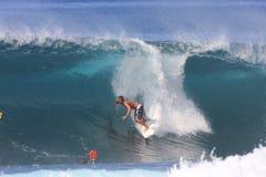 Hawaiian tube rider. Nov. 14: Stephen Koehne prepares to pull into a barrel at Backdoor on the North Shore of Hawaii Stock Photos
