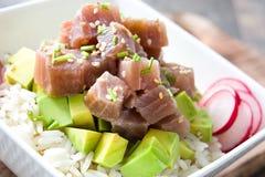Hawaiian tuna poke bowl with avocado, radishes and sesame seeds  Royalty Free Stock Image