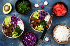 Hawaiian tuna poke bowl with seaweed, avocado, red cabbage, radishes and black sesame seeds. Hawaiian tuna poke bowl with seaweed, avocado, red cabbage Royalty Free Stock Photography