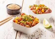 Hawaiian tuna poke. With mango, avocado, onion and sesame seeds Stock Photo