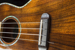 Hawaiian ukulele detail with rich wood grain textures. Stock Photography