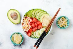Hawaiian watermelon poke bowl with avocado, cucumber, mung bean sprouts and pickled ginger. Top view, overhead Royalty Free Stock Photography