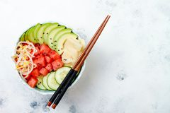 Hawaiian watermelon poke bowl with avocado, cucumber, mung bean sprouts and pickled ginger. Top view, overhead Royalty Free Stock Images