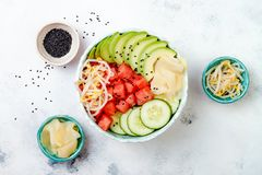 Hawaiian watermelon poke bowl with avocado, cucumber, mung bean sprouts and pickled ginger. Top view, overhead Stock Images