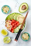 Hawaiian watermelon poke bowl with avocado, cucumber, mung bean sprouts and pickled ginger. Top view, overhead Stock Image