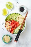 Hawaiian watermelon poke bowl with avocado, cucumber, mung bean sprouts and pickled ginger. Top view, overhead Stock Photography