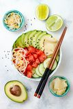 Hawaiian watermelon poke bowl with avocado, cucumber, mung bean sprouts and pickled ginger. Top view, overhead Royalty Free Stock Photos