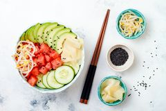 Hawaiian watermelon poke bowl with avocado, cucumber, mung bean sprouts and pickled ginger. Top view, overhead Royalty Free Stock Image