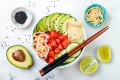 Hawaiian watermelon poke bowl with avocado, cucumber, mung bean sprouts and pickled ginger. Top view, overhead Royalty Free Stock Photo