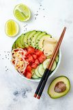 Hawaiian watermelon poke bowl with avocado, cucumber, mung bean sprouts and pickled ginger. Top view, overhead Stock Photos