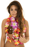 Hawaiian woman coconut bra close slight smile. A Hawaiian woman in her coconut bra with her lei around her neck with a small smile stock photography
