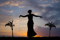 Hawaiian woman dancing in the sun Stock Photos