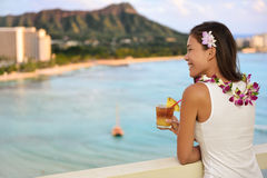 Hawaiian woman drinking Mai Tai in Waikiki, Hawaii Royalty Free Stock Photos