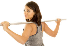 Hawaiian woman fitness bar on back look over shoulder Royalty Free Stock Photography