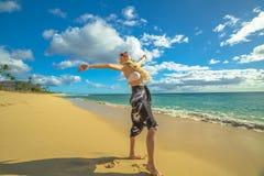 Hawaiian woman in Makua Beach. With flower neck garland. Waianae coast, Hawaii Oahu island royalty free stock photo