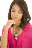 Hawaiian woman pink shirt hand under chin eyes down Stock Photography